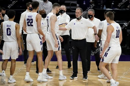 Northwestern head coach Chris Collins talks to his team during the first half of an NCAA college basketball game against Maryland in Evanston, Ill