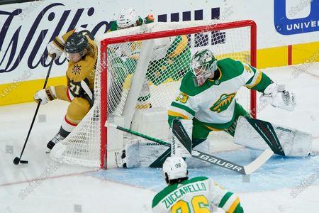 Vegas Golden Knights center William Karlsson (71) attempts a shot on Minnesota Wild goaltender Cam Talbot (33) during the first period of an NHL hockey game, in Las Vegas