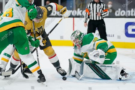 Stock Picture of Minnesota Wild goaltender Cam Talbot (33) stops an attempted shot by Vegas Golden Knights center Cody Glass (9) during the second period of an NHL hockey game, in Las Vegas