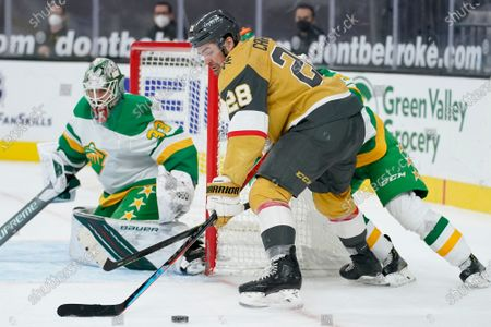 Vegas Golden Knights left wing William Carrier (28) looks to shoot against Minnesota Wild goaltender Cam Talbot (33) during the second period of an NHL hockey game, in Las Vegas