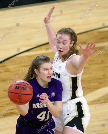 Washington guard Callie Lind (41) passes the ball as Colorado guard Frida Formann (3) defends during an NCAA college basketball game in the first round of the Pac-12 women's tournament, in Las Vegas
