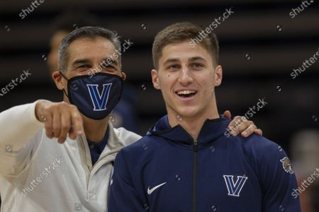 Villanova head coach Jay Wright and Villanova guard Collin Gillespie (2) before an NCAA college basketball game against Creighton, in Villanova, Pa