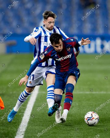 Adnan Januzaj of Real Sociedad CF competes for the ball with Antonio Garcia of Levante UD during the La Liga match between Real Sociedad CF and Levante UD at Reale Arena on March 07, 2021 in San Sebastian, Spain.