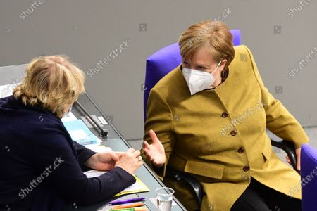 German Chancellor Angela Merkel (R) talks to German State Culture Minister Monika Gruetters (L) during a session at the German parliament Bundestag in Berlin, Germany, 04 March 2021. Members of the German parliament Bundestag discussed the ongoing COVID-19 pandemic situation in the country one day after new lockdown measures and opening scenarios were resolved.