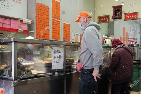 People buy food at a restaurant in San Francisco, the United States, March 3, 2021. U.S. San Francisco Mayor London Breed on Wednesday announced the launch of a new initiative to promote small business economic recovery and community vibrancy in the city.
