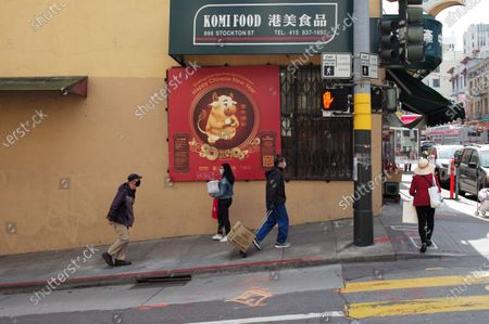 People wearing face masks walk on the street in China Town of San Francisco, the United States, March 3, 2021. U.S. San Francisco Mayor London Breed on Wednesday announced the launch of a new initiative to promote small business economic recovery and community vibrancy in the city.