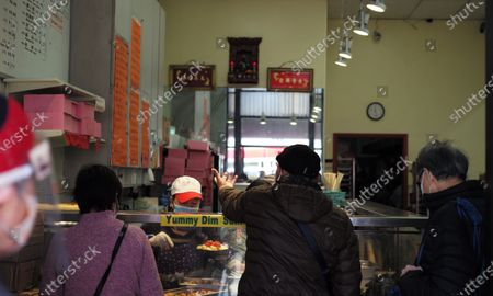 People buy food at a restaurant in China Town of San Francisco, the United States, March 3, 2021. U.S. San Francisco Mayor London Breed on Wednesday announced the launch of a new initiative to promote small business economic recovery and community vibrancy in the city.