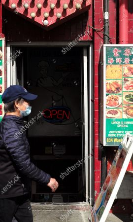 A pedestrian walks past a restaurant in San Francisco, the United States, March 3, 2021. U.S. San Francisco Mayor London Breed on Wednesday announced the launch of a new initiative to promote small business economic recovery and community vibrancy in the city.