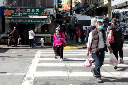 People wearing face masks walk on the street in San Francisco, the United States, March 3, 2021. U.S. San Francisco Mayor London Breed on Wednesday announced the launch of a new initiative to promote small business economic recovery and community vibrancy in the city.