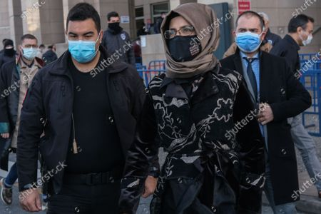 Hatice Cengiz (C), the fiancee of murdered Saudi journalist Jamal Khashoggi, leaves Caglayan Court House after a trial on Khashoggi's murder, in Istanbul, Turkey, 04 March 2021. Cengiz on 01 March issued a statement calling for justice over the killing of Khashoggi and demanded Saudi Crown Prince Mohammed bin Salman (MBS) be punished for his role in the murder after a US report by the Office of the Director of National Intelligence claimed MBS 'approved an operation in Istanbul, Turkey to capture or kill Saudi journalist Jamal Khashoggi'.