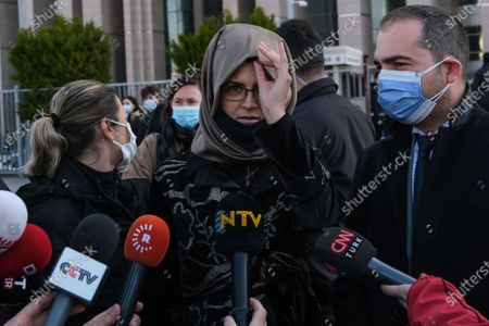 Hatice Cengiz (C), the fiancee of murdered Saudi journalist Jamal Khashoggi, speaks to the media after a trial on Khashoggi's murder, in Istanbul, Turkey, 04 March 2021. Cengiz on 01 March issued a statement calling for justice over the killing of Khashoggi and demanded Saudi Crown Prince Mohammed bin Salman (MBS) be punished for his role in the murder after a US report by the Office of the Director of National Intelligence claimed MBS 'approved an operation in Istanbul, Turkey to capture or kill Saudi journalist Jamal Khashoggi'.