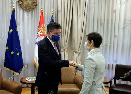 EU Special Representative for the Pristina-Belgrade Dialogue Miroslav Lajcak (L) fist bumps with Serbian Prime Minister Ana Brnabic (R) during their meeting in Belgrade, Serbia, 04 March 2021. EU Special Representative Lajcak is on two-day official visit to Serbia.