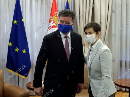 EU Special Representative for the Pristina-Belgrade Dialogue Miroslav Lajcak (L) poses for a photo with Serbian Prime Minister Ana Brnabic (R) during their meeting in Belgrade, Serbia, 04 March 2021. EU Special Representative Lajcak is on two-day official visit to Serbia.