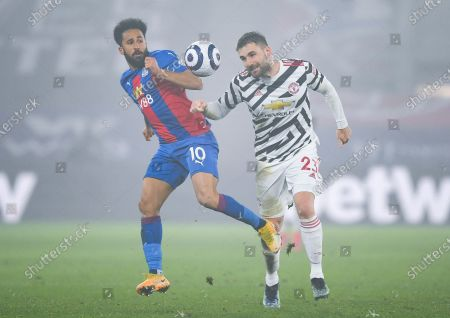 Andros Townsend of Crystal Palace and Luke Shaw of Manchester United