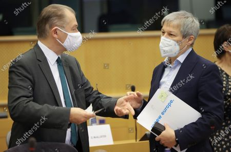 Stock Photo of European Parliament Greens group co-leader Philippe Lamberts (R) and the leader of EP Renew Europe party Dacian Ciolos (L) attend Conference of Presidents at the European parliament in Brussels, Belgium, 04 March 2021.