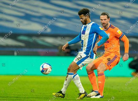 Fraizer Campbell of Huddersfield Town shields the ball; The John Smiths Stadium, Huddersfield, Yorkshire, England; English Football League Championship Football, Huddersfield Town versus Cardiff City.