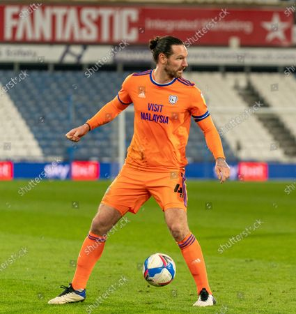 Sean Morrison of Cardiff City on the ball with 'fantastic' backdrop; The John Smiths Stadium, Huddersfield, Yorkshire, England; English Football League Championship Football, Huddersfield Town versus Cardiff City.