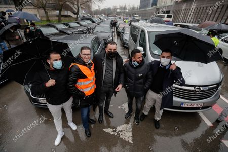 Drivers of LVC (vehicle rental with driver), who use the Uber application to work, demonstrate in the streets of Brussels against the new law put in place prohibiting LVC drivers from using their smartphones to work in Brussels, Belgium, 04 March 2021. Drivers protest, organized by the Union Syndicale des Chauffeurs Prives and the Belgian Association of Limousine Drivers, is against the announcement by Brussels Minister-President Rudi Vervoort to conduct control operations for LCV drivers, who use their smartphones to take reservations, via the Uber platform.