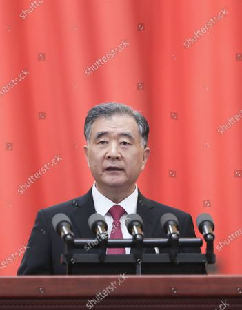 Wang Yang, chairman of the Chinese People's Political Consultative Conference (CPPCC) National Committee, delivers a work report of the Standing Committee of the CPPCC National Committee at the opening meeting of the fourth session of the 13th CPPCC National Committee at the Great Hall of the People in Beijing, capital of China, March 4, 2021.
