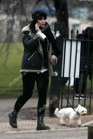 Stock Image of Daisy Lowe walking her dog Monty in Primrose Hill