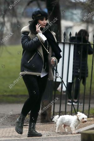 Stock Picture of Daisy Lowe walking her dog Monty in Primrose Hill