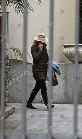 Stock Image of Infanta Elena, sister of King Felipe VI of Spain, leaves the headquarters of Maphre Foundation where she works in Madrid, Spain, 04 March 2021. The Spanish Royal family has found itself at the heart of another scandal after it was revealed that the sisters of King Felipe VI, Elena and Cristina, were vaccinated against Covid-19 during a trip to the United Arab Emirates, where they went to visit their father, the self-exiled former monarch Juan Carlos I. According to both of them, they accepted to be vaccinated during their trip in order to have a health passport that would allow them visit their father at the Arab country.