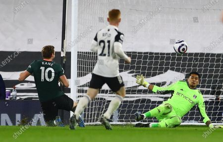 Goalkeeper Alphonse Areola of Fulham saves from Harry Kane of Tottenham Hotspur