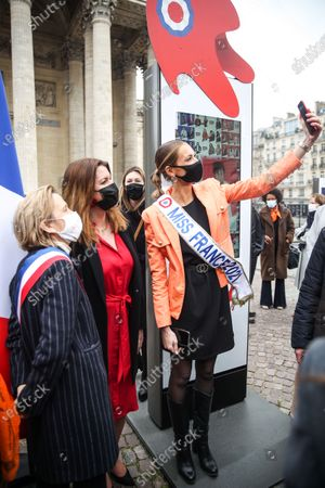 Miss France 2021 Amandine Petit (C) takes a photograph with French Junior Minister of Citizenship Marlene Schiappa (2-L), and French politician Florence Berthout (L) at the opening day of '109 Mariannes' exhibition at Pantheon square in Paris, France, 04 March 2021. French Junior Minister of Citizenship Schiappa inaugurated the exhibition of '109 Mariannes', that runs from 04 to 15 March at the square of the Pantheon, on the occasion of International Women's Day marked on 08 March. Marianne is a symbolic figure of the French Republic, embodies the values of France 'Liberty, equality, fraternity'. French Interior Ministry in 2021 wants to promote new blood for the Republic through 109 portraits of women representing France and its diversity.