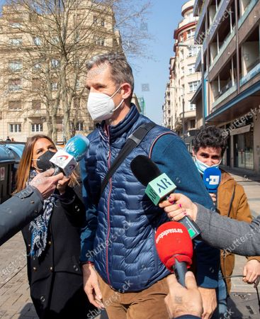 The brother-in-law of Spanish King Felipe VI, Inaki Urdangarin (C), is surrounded by reporters after his first day of work in a lawyers company in Vitoria, Basque Country, Spain, 04 March 2021. Inaki Urdangarin, who was sentenced to five years and ten months for corruption in the Noos' case, has been moved to the open regimen Alava's prision, close to Vitoria, where he has to sleep from Mondays to Thursdays, while during the morning he will work as an advisor in the law firm.