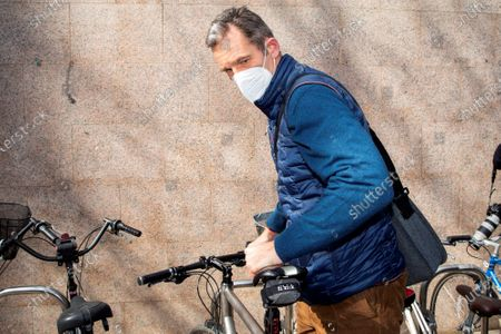 Stock Image of The brother-in-law of Spanish King Felipe VI, Inaki Urdangarin, leaves after his first day of work in a lawyers company in Vitoria, Basque Country, Spain, 04 March 2021. Inaki Urdangarin, who was sentenced to five years and ten months for corruption in the Noos' case, has been moved to the open regimen Alava's prision, close to Vitoria, where he has to sleep from Mondays to Thursdays, while during the morning he will work as an advisor in the law firm.
