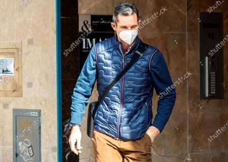 Stock Photo of The brother-in-law of Spanish King Felipe VI, Inaki Urdangarin, leaves after his first day of work in a lawyers company in Vitoria, Basque Country, Spain, 04 March 2021. Inaki Urdangarin, who was sentenced to five years and ten months for corruption in the Noos' case, has been moved to the open regimen Alava's prision, close to Vitoria, where he has to sleep from Mondays to Thursdays, while during the morning he will work as an advisor in the law firm.
