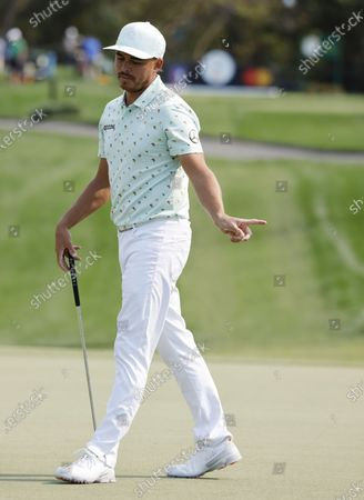 Rickie Fowler of the US reacts to his putt on the seventh hole during the first round of the Arnold Palmer Invitational presented by Mastercard golf tournament at the Bay Hill Club & Lodge in Orlando, Florida, USA, 04 March 2021.