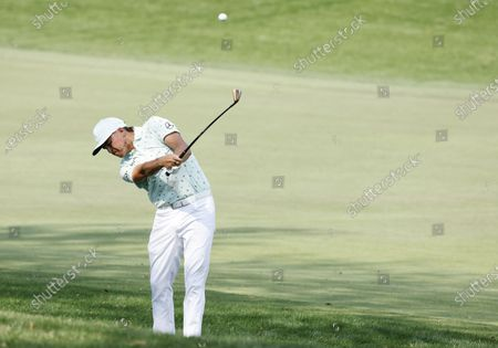 Rickie Fowler of the US hits from the rough on the eighth hole during the first round of the Arnold Palmer Invitational presented by Mastercard golf tournament at the Bay Hill Club & Lodge in Orlando, Florida, USA, 04 March 2021.
