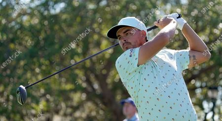 Rickie Fowler tees off on the 11th hole during the first round of the Arnold Palmer Invitational golf tournament, in Orlando, Fla