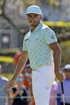 Rickie Fowler reacts to a missed birdie putt on the 10th green during the first round of the Arnold Palmer Invitational golf tournament, in Orlando, Fla