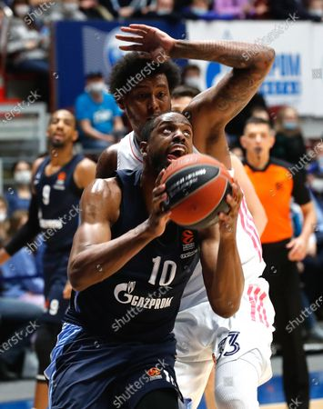 Trey Thompkins (back) of Madrid in action against Will Thomas (front) of Zenit during the Euroleague basketball match between BC Zenit St. Petersburg and Real Madrid in St. Petersburg, Russia, 04 March 2021.