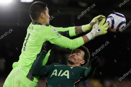 Fulham's goalkeeper Alphonse Areola blocks Tottenham's Dele Alli's header during the English Premier League soccer match between Fulham v Tottenham Hotspur at the Craven Cottage stadium in London