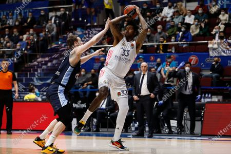 Trey Thompkins (R) of Real Madrid in action against Andrey Zubkov of Zenit St Petersburg during the EuroLeague Basketball match between Zenit St. Petersburg and Real Madrid on March 4, 2021 at Sibur Arena in Saint Petersburg, Russia.
