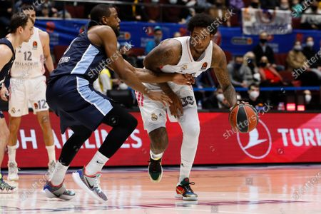Trey Thompkins (R) of Real Madrid in action against Will Thomas of Zenit St Petersburg during the EuroLeague Basketball match between Zenit St. Petersburg and Real Madrid on March 4, 2021 at Sibur Arena in Saint Petersburg, Russia.