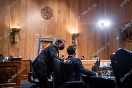 Stock Photo of United States Senator Jon Ossoff (Democrat of Georgia), right, and United States Senator Gary Peters (Democrat of Michigan), left, confer during a Senate Committee on the Budget hearing to examine the nominations of Shalanda D. Young to be Deputy Director of the Office of Management and Budget and Jason Scott Miller, to be Deputy Director for Management of the Office of Management and Budget, in the Dirksen Senate Office Building in Washington, DC,.