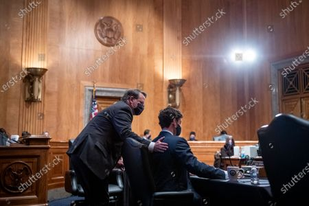 United States Senator Jon Ossoff (Democrat of Georgia), right, and United States Senator Gary Peters (Democrat of Michigan), left, confer during a Senate Committee on the Budget hearing to examine the nominations of Shalanda D. Young to be Deputy Director of the Office of Management and Budget and Jason Scott Miller, to be Deputy Director for Management of the Office of Management and Budget, in the Dirksen Senate Office Building in Washington, DC,.