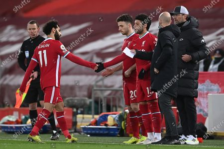 Liverpool's Alex Oxlade-Chamberlain (3-R) enters the field as substitute for Mohamed Salah (L) during the English Premier League soccer match between Liverpool FC and Chelsea FC in Liverpool, Britain, 04 March 2021.