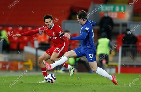 Liverpool's Trent Alexander-Arnold, left, challenges for the ball with Chelsea's Ben Chilwell during the English Premier League soccer match between Liverpool and Chelsea at Anfield stadium in Liverpool, England