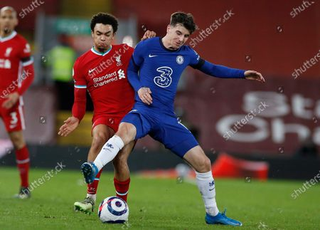 Chelsea's Mason Mount, right, challenges for the ball with Liverpool's Trent Alexander-Arnold during the English Premier League soccer match between Liverpool and Chelsea at Anfield stadium in Liverpool, England