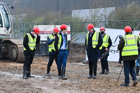Stock Picture of Laying of the first stone of the new expansion of the Beyers factory, in the presence of Minister Jan Jambon, Hilde Crevits and Mayor Koen Van den Heuvel. The Beyers factory specializing in coffee thus confirms its desire to expand in Belgium.