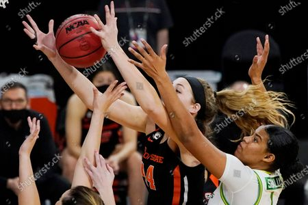Oregon's Nyara Sabally, right, and Oregon State's Taylor Jones battle for a rebound during the first half of an NCAA college basketball game in the second round of the Pac-12 women's tournament, in Las Vegas