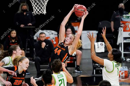 Oregon State's Taylor Jones (44) grabs a rebound against the Oregon during the first half of an NCAA college basketball game in the second round of the Pac-12 women's tournament, in Las Vegas