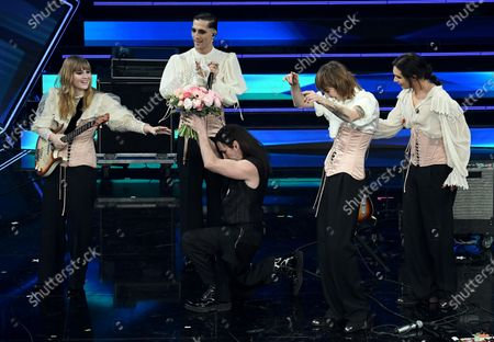Italian band Maneskin with Italian singer Manuel Agnelli (C) perform on stage at the Ariston theater during the 71st Sanremo Italian Song Festival, in Sanremo, Italy, 04 March 2021. The festival runs from 02 to 06 March.