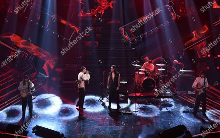 Italian band Maneskin with Italian singer Manuel Agnelli (C-R) perform on stage at the Ariston theater during the 71st Sanremo Italian Song Festival, in Sanremo, Italy, 04 March 2021. The festival runs from 02 to 06 March.
