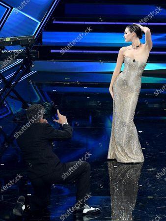 Italian showman Rosario Fiorello and Italian model Vittoria Ceretti on stage at the Ariston theatre during the 71st Sanremo Italian Song Festival, in Sanremo, Italy, 04 March 2021. The festival runs from 02 to 06 March.